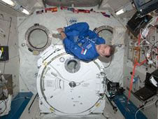 Flight Engineer Pavel Vinogradov uses<br /> some of his personal time onboard the<br /> International Space Station to take<br /> advantage of the weightless environment.<br /> Credit: NASA<br /> <br />